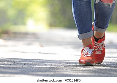 Girl walking on road low angle view