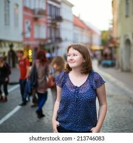 Girl walking on a street of Vilnius, Lithuania