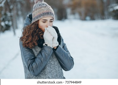 Girl walking in a park on a sunny winter day