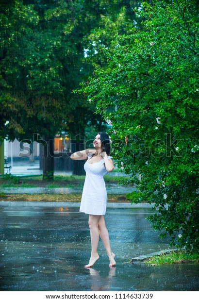 A girl walking in the summer rain without an umbrella