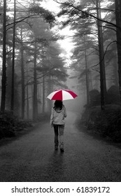 Girl walking with an umbrella on a winter rainy day