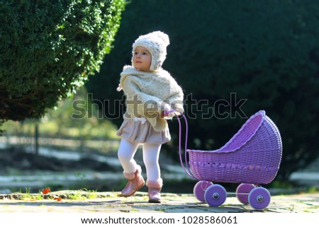 a4d8bc020 Girl Walking Vintage Doll Stroller On Stock Photo (Edit Now ...