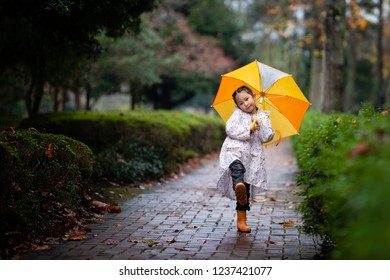 Girl walking wearing a raincoat