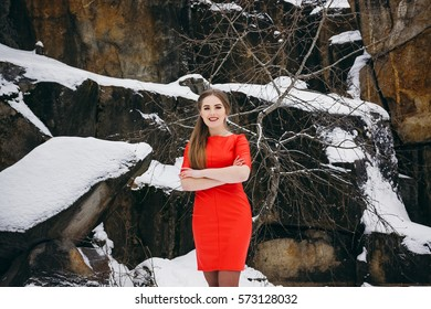 Girl walking in winter forest and canyon