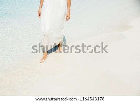 a49194671 ... Stock Photo (Edit Now) 1164543178 - Shutterstock. Girl walks the beach  and in the water