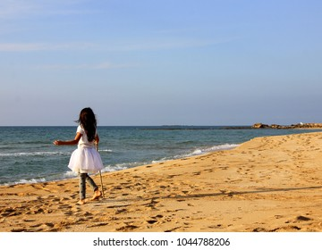 girl walks by the sea