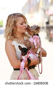 Girl walks with her friends - cute small dogs
