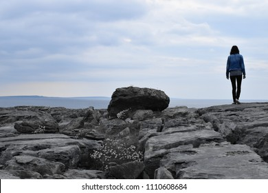 Girl walks on the ground of The Burren national park