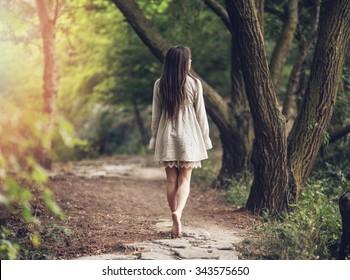 Girl walks in the park.
