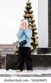 Girl walks in winter in the city