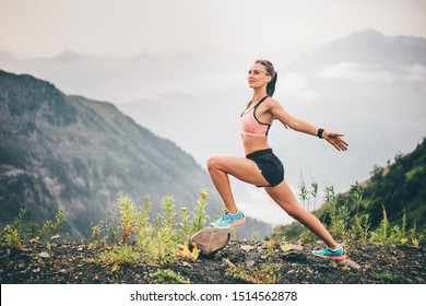 Girl warming up outdoor. Young female runner stretching before running at the mountain. Athlete at the top of the mountain.