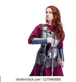 girl warrior in chain mail and with sword in hand, woman viking in historical battle armor, Middle Ages