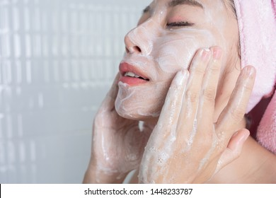 Girl washes the morning face in the bathroom.