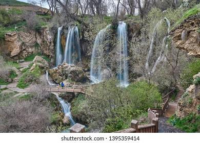 Girl is watching the beauty of waterfall. Sizir Waterfall, in May, spring, Gemerek, Sivas, Turkey
