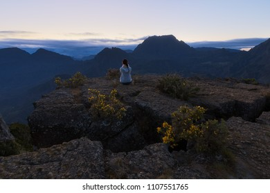 Girl watching the Piton des Neiges at Maiido in Saint Paul, Reunion Island