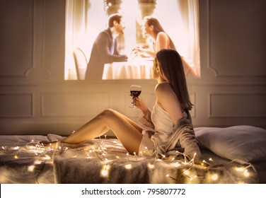 Girl watching a romantic film at home