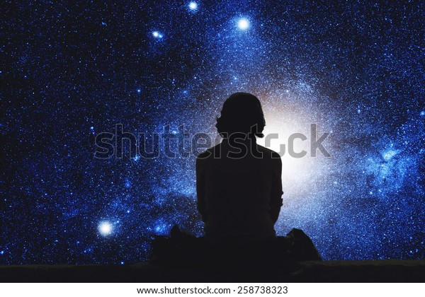 Girl watching the space. Stars are digital illustration.