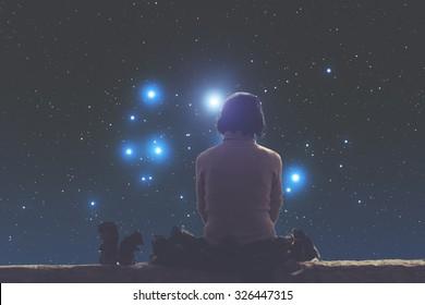 Girl watching the stars. Stars are taken through my telescope.
