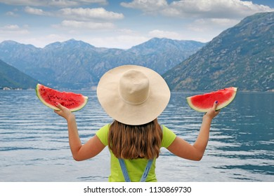 girl with watermelon on summer vacation