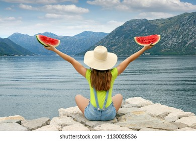 girl with watermelon sitting near sea summer vacation