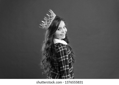 Girl wear crown red background. Spoiled child concept. Egocentric princess. World spinning around me. Kid wear golden crown symbol princess. Every girl dreaming become princess. Lady little princess.