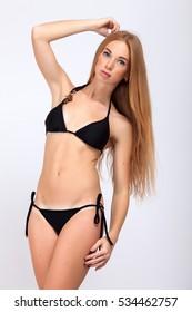 girl wear swimwear at studio