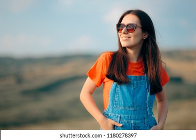 Girl Wearing Cool Sunglasses Relaxing in Nature. Happy traveler in ecotourism journey in beautiful nature