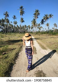 girl wearing elephant pants harem pants on the island