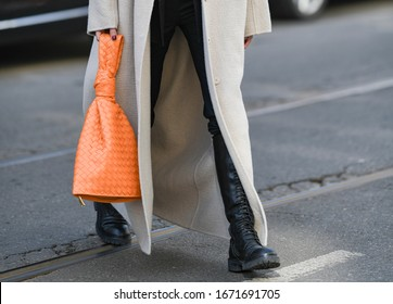 Girl wearing a fancy hand bag - street style outfit