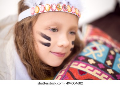 Girl wearing indian hair band on her head