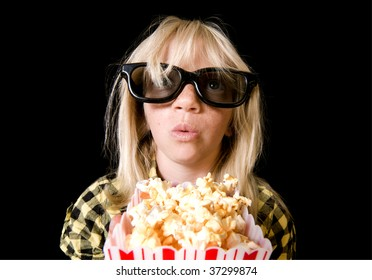 Girl Wearing New Style 3-D Glasses in a Movie Theater