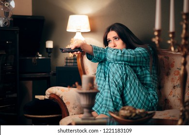 Girl Wearing Pajamas Watching TV in her Room. Funny woman binging television on programs and series