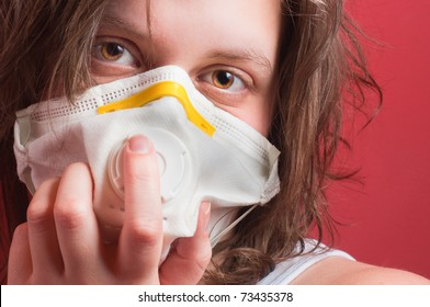 girl wearing protective mask against red background