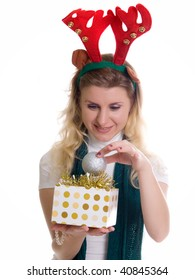 girl wearing a reindeer headband with a gift. Isolated on white