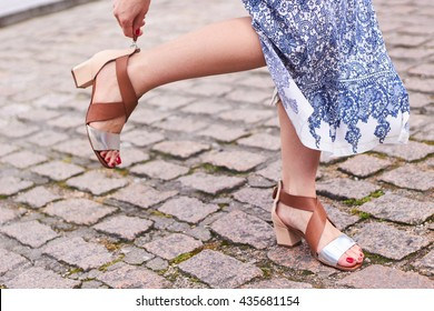 Girl wearing sandals and blue dress on the street
