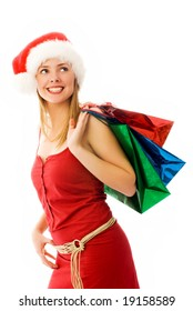 girl wearing Santa's hat with Christmas presents
