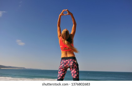 Girl wearing sport style clothes on the beach