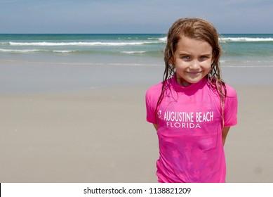 Girl wearing a St. Augustine Beach shirt on the beach