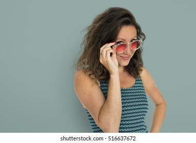 Girl wearing sunglasses portrait on green background