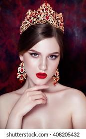 Girl wearing tiara and sparkling jewlery.