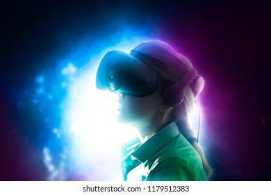 Girl wearing the virtual reality goggles.