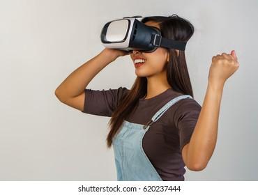 girl wearing a virtual reality goggles and having fun