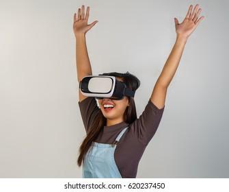 girl wearing a virtual reality goggles having fun