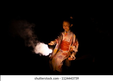 Girl wearing a yukata to the fireworks