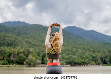 The girl wears a fitness suit that is fit for flexibility in jogging in the morning, and the exercise suit also helps to cool the heat and sweat for comfort during the run