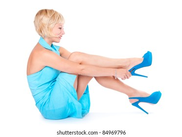 The girl wears a shoe, white background