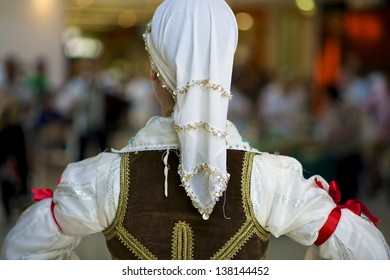 A girl wears traditional serbian costume