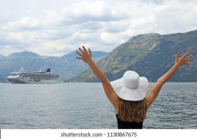 The girl welcomes the cruise ship Kotor bay Montenegro summer vacation