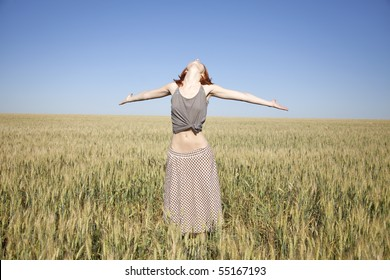 Girl at wheat field