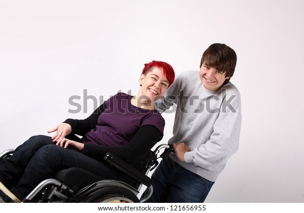 Girl in wheelchair with Helper